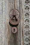 Close up detail of door handle and keyhole on church door,