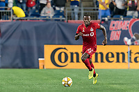 FOXBOROUGH, MA - AUGUST 31: Richie Laryea #22 of Toronto FC brings the ball forward during a game between Toronto FC and New England Revolution at Gillette Stadium on August 31, 2019 in Foxborough, Massachusetts.