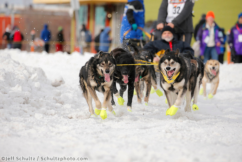 Brent Sass and team run down 4th avenue during the Ceremonial Start of the 2016 Iditarod in Anchorage, Alaska.  March 05, 2016