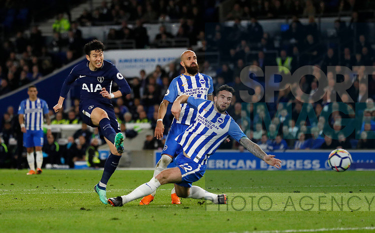 Son Heung-Min of Tottenham shoots past Shane Duffy of Brighton during the premier league match at the Amex Stadium, London. Picture date 17th April 2018. Picture credit should read: David Klein/Sportimage