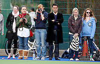 Spectators look on during the England Hockey League Mens Semi-Final Cup game between Hampstead & Westminster and Sevenoaks at the Paddington Recreation Ground, Maida Vale on Sun March 21, 2010