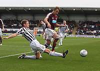 David van Zanten stretches to beat Arvydas Novikovas in the St Mirren v Heart of Midlothian Clydesdale Bank Scottish Premier League match played at St Mirren Park, Paisley on 15.9.12.