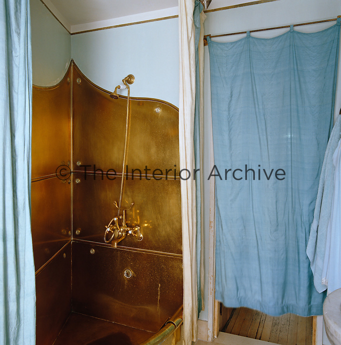 The bathroom features an unusual copper bath and shower fitting that were shipped over from Italy