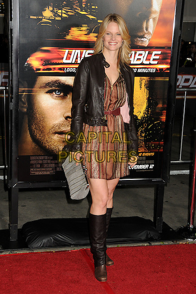 "JOELLE CARTER.""Unstoppable"" Los Angeles Premiere held at the Regency Village Theatre, Westwood, California, USA..October 26th, 2010.full length leather jacket brown striped dress knee high boots black.CAP/ADM/BP.©Byron Purvis/AdMedia/Capital Pictures."