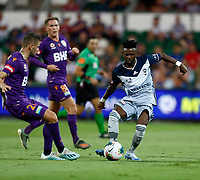 1st February 2020; HBF Park, Perth, Western Australia, Australia; A League Football, Perth Glory versus Melbourne Victory; Elvis Kamsoba of Melbourne Victory passes the ball across the top of the box as Jake Brimmer of Perth Glory challenges