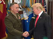 United States President Donald J. Trump, right shakes hands with US Marine Corps General Joseph F. Dunford Jr., Chairman, Joint Chiefs of Staff, left, prior to making remarks and signing H.R. 2810, National Defense Authorization Act for Fiscal Year 2018, in the Roosevelt Room of the White House in Washington, DC on Tuesday, December 12, 2017.<br /> Credit: Ron Sachs / CNP