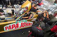 Sep 23, 2016; Madison, IL, USA; NHRA driver Leah Pritchett, pilot of the Papa Johns Pizza sponsored top fuel dragster of Don Schumacher Racing sits in her car as crew members surround the engine during qualifying for the Midwest Nationals at Gateway Motorsports Park. Mandatory Credit: Mark J. Rebilas-USA TODAY Sports