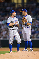 Durham Bulls first baseman J.P. Arencibia (right) has a chat with starting pitcher Brandin Hagens (left) during the game against the Charlotte Knights at BB&T BallPark on July 22, 2015 in Charlotte, North Carolina.  The Knights defeated the Bulls 6-4.  (Brian Westerholt/Four Seam Images)