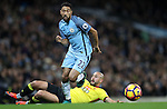 Gael Clichy of Manchester City and Nordin Amrabat of Watford during the English Premier League match at The Etihad Stadium, Manchester. Picture date: December 12th, 2016. Photo credit should read: Lynne Cameron/Sportimage