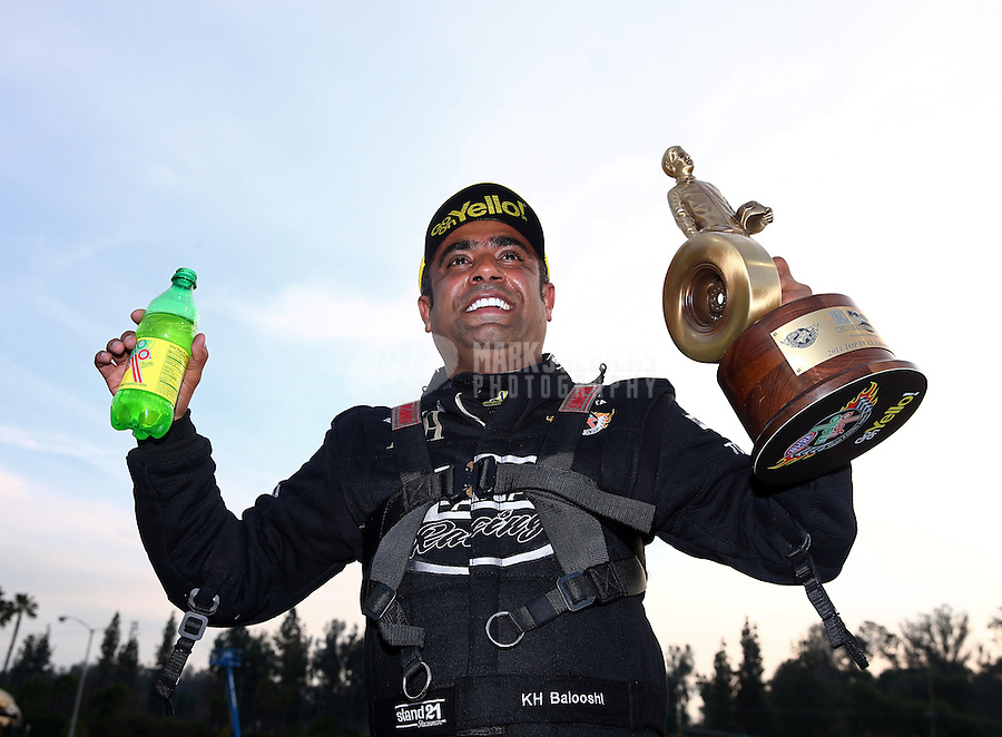 Feb 9, 2014; Pomona, CA, USA; NHRA top fuel dragster driver Khalid Albalooshi celebrates after winning the Winternationals at Auto Club Raceway at Pomona. Mandatory Credit: Mark J. Rebilas-