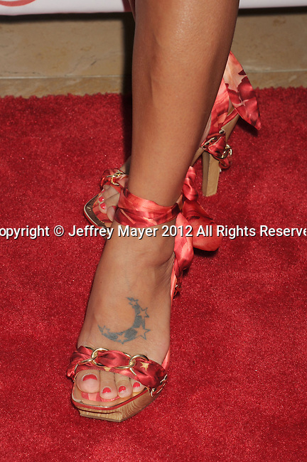 BEVERLY HILLS, CA - SEPTEMBER 28: Bai Ling  attends Operation Smile's 30th Anniversary Smile Gala - Arrivals at The Beverly Hilton Hotel on September 28, 2012 in Beverly Hills, California.