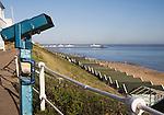 Blue telescope, beach huts, pier, sea, sandy beach at Southwold, Suffolk, England