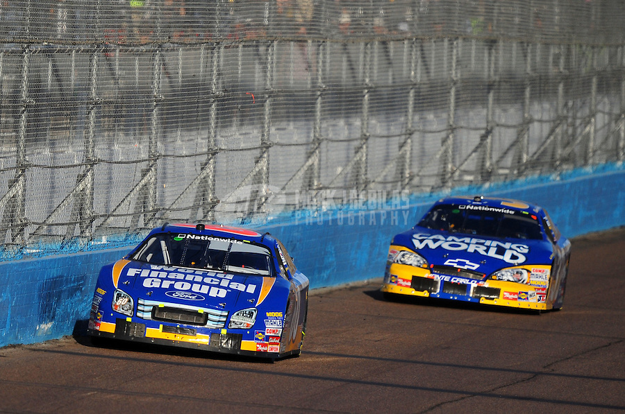 Nov. 8, 2008; Avondale, AZ, USA; NASCAR Nationwide Series driver Carl Edwards (60) leads Kevin Harvick during the Hefty Odor Block 200 at Phoenix International Raceway. Mandatory Credit: Mark J. Rebilas-