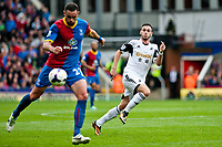 Sun 22 September 2013<br /> <br /> Pictured: Alvaro Vasquez chases the ball being taken forward by Damien Delaney of Crystal Palace<br /> <br /> Re: Barclays Premier League Crystal Palace FC  v Swansea City FC  at Selhurst Park, London