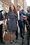Pic shows: Rebekah Brooks and Charlie Brooks on steps of their home tonight after making statement<br /> Staff left with their bags and put them in a  Range Rover<br /> <br /> <br /> Pic by Gavin Rodgers/Pixel 8000 Ltd