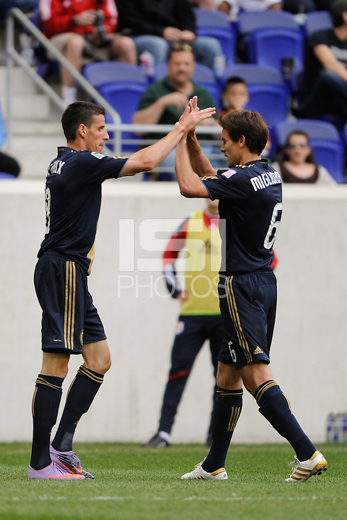Sebastien Le Toux (9) of the Philadelphia Union  celebrates scoring with Stefani Miglioranzi (6). The New York Red Bulls defeated the Philadelphia Union 2-1 during a Major League Soccer (MLS) match at Red Bull Arena in Harrison, NJ, on April 24, 2010.