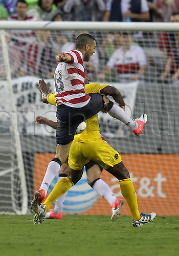08.06.2012. Tampa, Florida, USA.  Clint Dempsey (8) of USA MNT shoots past Mark McCoy (2) of Antigua & Barbuda during a 2014 FIFA World Cup qualifying match at Raymond James Stadium in Tampa, Florida. USA won 3-1.