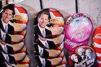 Pins and buttons designed by Tom Bragg of Dallas, Texas, hang on a board for sale at a Rick Santorum town hall in Northfield, New Hampshire.  Santorum is seeking the 2012 Republican nomination for president. The buttons sold 3 for $10.