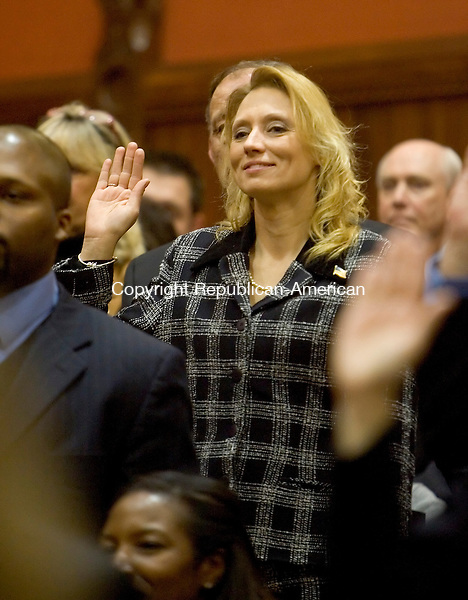 HARTFORD, CT- 07 JANUARY 2008 --010709JS06-Rep. Michelle L. Cook, D-Torrington, center, is sworn in on Wednesday during the opening day of the general assembly at the state Capitol in Hartford. Cook was one of the 24 new representatives sworn-in during the ceremony. <br /> Jim Shannon / Republican-American