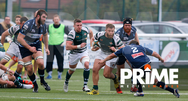 Bedford's Benjamin Adams makes the catch under pressure during the Greene King IPA Championship match between Ealing Trailfinders and Bedford Blues at Castle Bar , West Ealing , England  on 29 October 2016. Photo by Carlton Myrie / PRiME Media