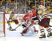 Barry Almeida (BC - 9), Clay Witt (Northeastern - 31), Bill Arnold (BC - 24) - The Boston College Eagles defeated the Northeastern University Huskies 7-1 in the opening round of the 2012 Beanpot on Monday, February 6, 2012, at TD Garden in Boston, Massachusetts.