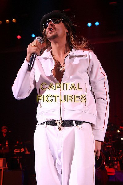 KID ROCK.Performs live in concert at the Carling Apollo in Hammersmith, London, England, UK, November 30th 2008..music live on stage gig half length black hat sunglasses white tracksuit top jacket zip up belt ring necklace microphone buffalo head belt buckle .CAP/MAR.©Martin Harris/Capital Pictures