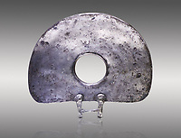 "Bronze Age Hattian ceremonial standard known as ""Sun Disks"" in silver from a possible Bronze Age Royal grave (2500 BC to 2250 BC) - Alacahoyuk - Museum of Anatolian Civilisations, Ankara, Turkey. Against a gray background"