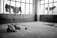 A lone patient lies on the floor at the Rajan Babu TB hospital in New Delhi, India.