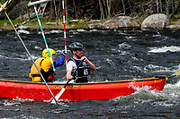 Canoeists competing in the Hudson River White Water Derby in the Adirondack Forest Preserve, New York