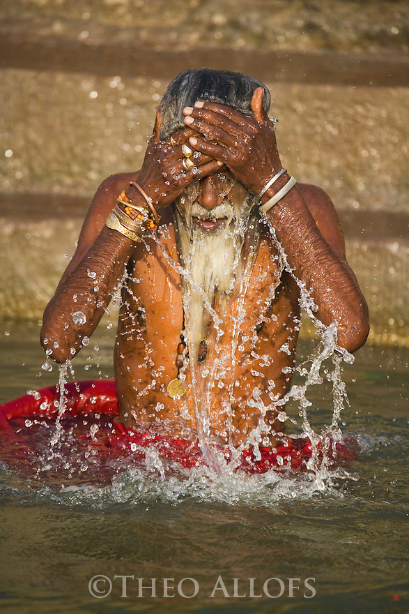 Arresting Sadhus Portrait Photography Religious Photography: Indian Holy Man (Sadhu) Washing Himself In Ganges River