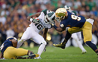 Cornerback KeiVarae Russell (6) and linebacker Jaylon Smith (9) tackle Michigan State Spartans wide receiver Aaron Burbridge (16) in the fourth quarter.