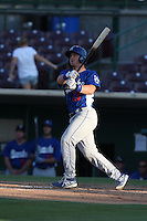 Kyle Farmer #25 of the Rancho Cucamonga Quakes bats against the Inland Empire 66ers at San Manuel Stadium on August 10, 2014 in San Bernardino, California. Inland Empire defeated Rancho Cucamonga, 4-1. (Larry Goren/Four Seam Images)