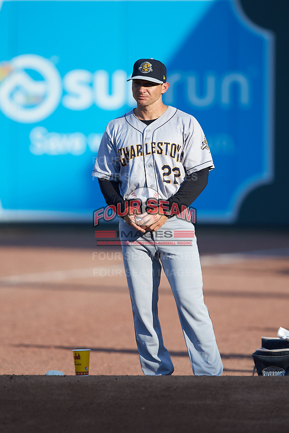 Charleston RiverDogs pitching coach Justin Pope (22) watches his starting pitcher warm-up in the bullpen prior to the game against the Columbia Fireflies at Spirit Communications Park on June 9, 2017 in Columbia, South Carolina.  The Fireflies defeated the RiverDogs 3-1.  (Brian Westerholt/Four Seam Images)