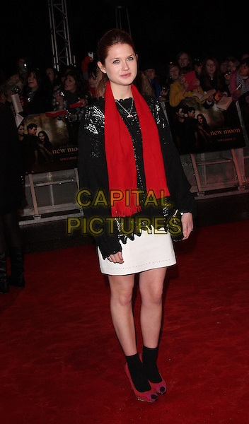"BONNIE WRIGHT .Agttending ""The Twilight Saga: New Moon"" Fan Event at the Battersea Evolution, London, England, UK, November 11th 2009.full length red scarf white skirt black jumper sweater top socks ankle peep toe shoes clutch bag.CAP/ROS.©Steve Ross/Capital Pictures."