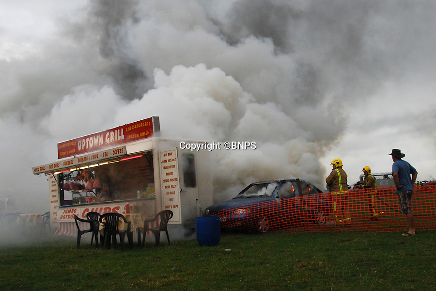 BNPS.co.uk (01202 558833)<br /> Picture: BNPS<br /> <br /> This is the moment show marshalls and the Light Aviation Fire and Rescue Service rushed to stop a flaming car careering into a nearby food truck.<br /> <br /> The car was part of a demonstration at the Somerset Steam and Country Fair at Low Ham, near Langport, in Somerset as part of their car fire demonstration.