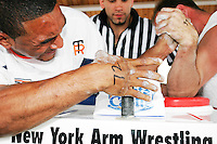 Arm wrestlers compete at the Staten Island Borough Championship on June 18, 2005.