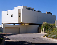 The rear of the house is dominated by a floating rendered facade