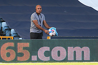 A member of the Millwall staff wipes the ball after it was retrieved from the stand during Millwall vs Stoke City, Sky Bet EFL Championship Football at The Den on 12th September 2020