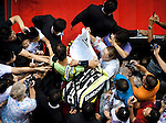 BANGKOK, THAILAND - SEPTEMBER 30:  Rafael Nadal of Spain is escorted as he arrives to the court before his match against Ruben Bemelmans of Belgium during the Day 6 of the PTT Thailand Open at Impact Arena on September 30, 2010 in Bangkok, Thailand. Photo by Victor Fraile / The Power of Sport Images