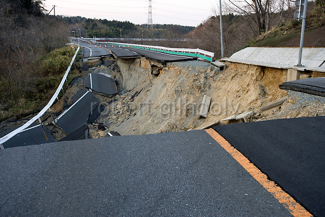 Photo shows the road wrecked by the March 11 quake just outside the Fukushima No. 2 nuclear power plant,w which lies inside the evacuation zone in Tomioka, Fukushima Prefecture, Japan on 13 April, 2011. .Photographer: Robert Gilhooly