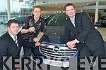 Kerry Captain Colm Cooper who picked up the keys for his new sponsored Opel Insignia with Pat left and Paul Ahern in Ahern's Garage Castleisland on Tuesday