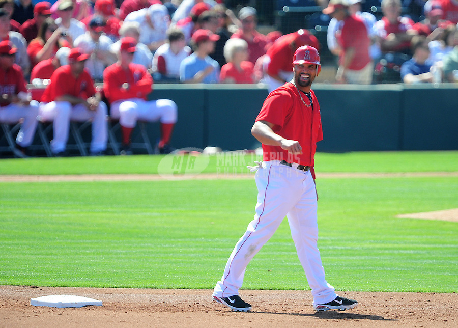Mar. 6, 2012; Tempe, AZ, USA; Los Angeles Angels designated hitter Albert Pujols laughs as he leads off second base in the first inning against the Chicago White Sox during a spring training game at Tempe Diablo Stadium.  Mandatory Credit: Mark J. Rebilas-