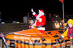 Santa arrives at Ballyheigue beach by boat  escorted by the local rescue team as a massive crowd await him on the promenade last Sunday.
