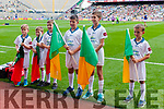 Kerry flag bearers await Kerry v Mayo teams in the All Ireland Semi Final Replay in Croke Park on Saturday.