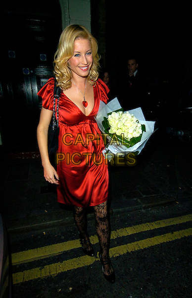 "DENISE VAN OUTEN .The ""Rent"" Press night afterparty at Jewell Bar, Covent Garden, London, England..October 15th, 2007.full length red satin silk dress black lace patterned tights flowers bouquet heart necklace .CAP/CAN.©Can Nguyen/Capital Pictures"