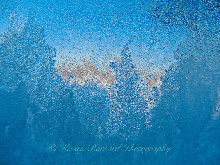 On this morning in Northwest Montana it was sunny and 15 degrees below zero. Ice crystals formed on my kitchen window creating this beautiful winter landscape. A study in natural blues. Or, should that be a study in natural hues?