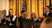 Washington, DC - November 23, 2009 -- United States President Barack Obama presents the 2009 Robert F.Kennedy Human Rights Award to Magodonga Mahlangu and the Women of Zimbabwe Arise in the East Room of the White House on November 23rd 2009.  left to right:  Jenni Williams (WOZA), Magodonga Mahlangu, Ethel Kennedy, President Obama. .Credit: Dennis Brack / Pool via CNP