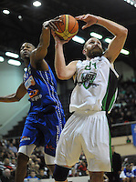 Saints import Bryant Markson tries to block Nick Horvath during the national basketball league match between Wellington Saints and Manawatu Jets at TSB Bank Arena, Wellington, New Zealand on Tuesday, 7 May 2013. Photo: Dave Lintott / lintottphoto.co.nz