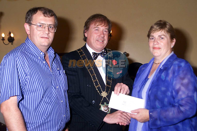 Joe Lawlor and Deirdre Russell and Mayor Frank Godfrey..Picture Paul Mohan Newsfile..Camera:   DCS620C.Serial #: K620C-00788.Width:    1728.Height:   1152.Date:  8/10/00.Time:   0:14:37.DCS6XX Image.FW Ver:   3.0.9.TIFF Image.Look:   Product.Sharpening Requested: No.Tagged.Counter:    [21425].Shutter:  1/60.Aperture:  f5.6.ISO Speed:  400.Max Aperture:  f3.5.Min Aperture:  f22.Focal Length:  24.Exposure Mode:  Manual (M).Meter Mode:  Color Matrix.Drive Mode:  Continuous High (CH).Focus Mode:  Single (AF-S).Focus Point:  Center.Flash Mode:  Normal Sync.Compensation:  +0.0.Flash Compensation:  +0.0.Self Timer Time:  10s.White balance: Preset (Flash).Time: 00:14:37.126.