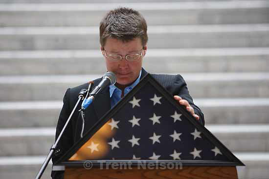 Valerie Larabee calls for a moment of silence at a rally in honor of gay and lesbian veterans sponsored by the The Utah Pride Center at the Utah State Capitol Wednesday, November 11 2009.